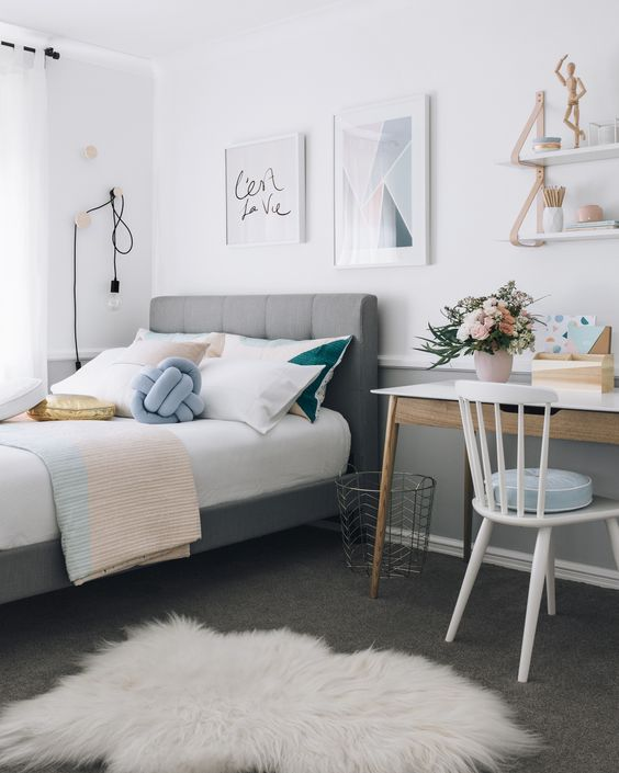 Going with mellow blues and tans is a great way to make your room have that mellow feeling for that relaxation. This tufted bed is about as comfortable as it gets.