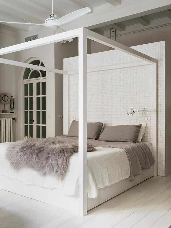 A canopy bed with a trendy ceiling fan carries a spectacle in design and helps cool off those summers. The brick behind the bed is highly unique to make this bedroom stand out.