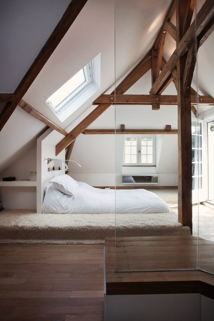 What a cool idea for an attic space. Stained wood beams are a grand measure that really helps get that wow-effect.