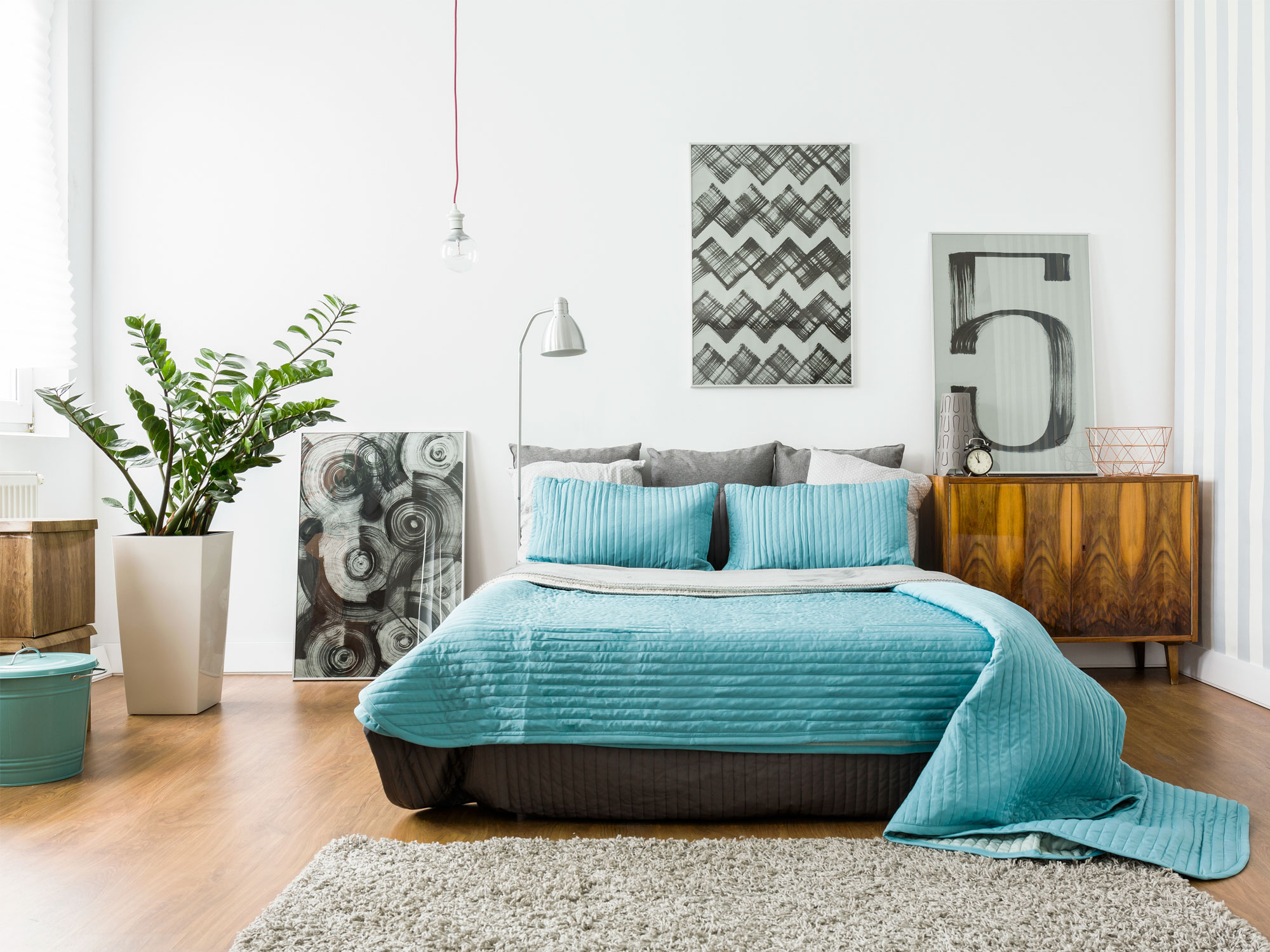 Truly an outstanding combination with beach-color blue meshing with natural wood and a plant to lighten the mood. Studies have shown that having plants in your home can act as a natural stress reliever.
