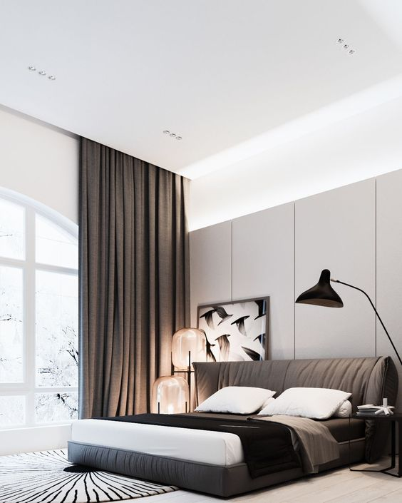 Here's a luxurious bed that gives the sensation of living in a highrise hotel room. The decorative fabric-covered headboard and railing makes this bedroom soft to the touch and the wall-high curtains give those ultra-dark nights and help you sleep through the night.
