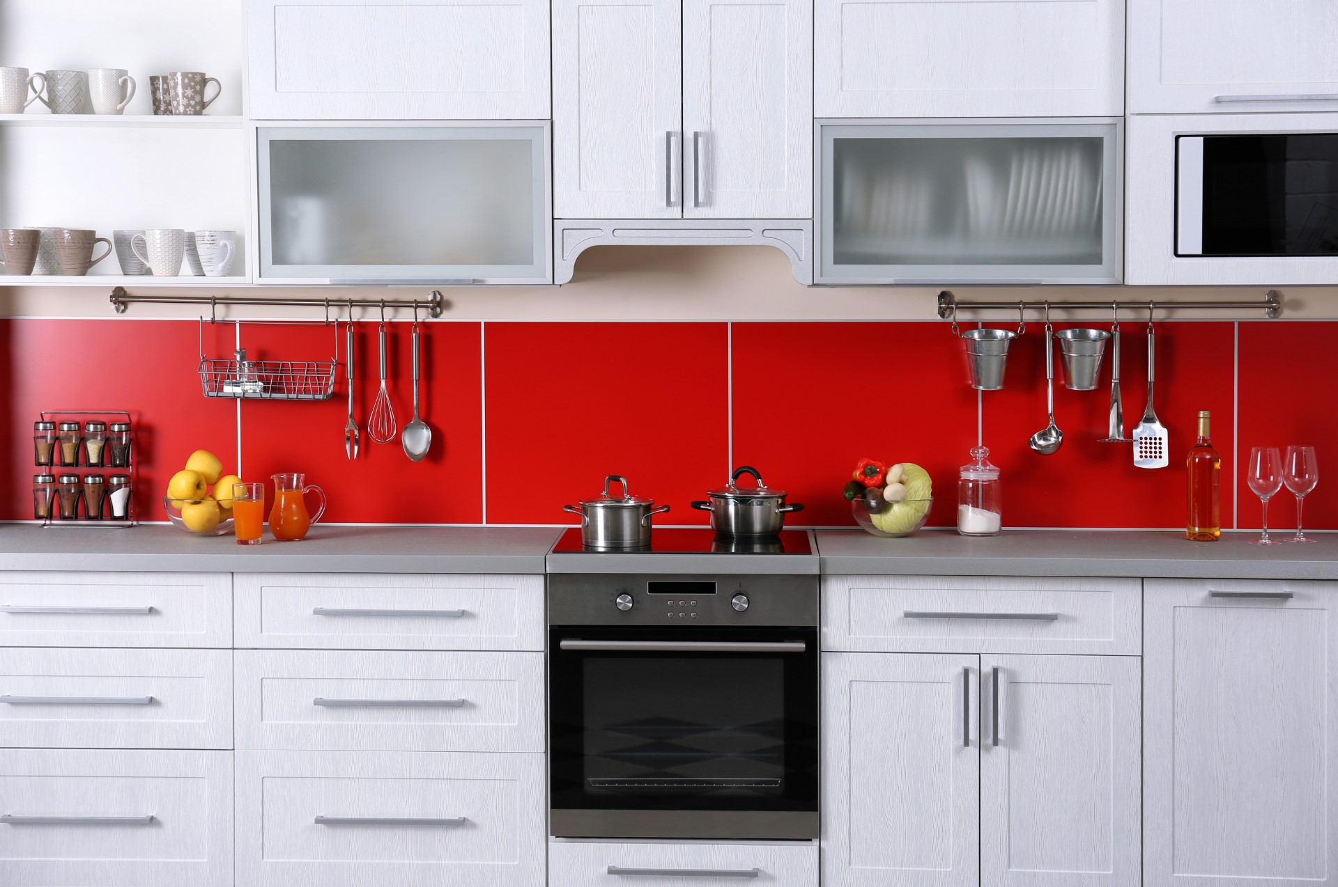 If you're looking for a design that shows character and personality, there's no better way to show it than a bright color like red as a backsplash to your countertop. Something like this would be great for a college dorm, or just an all-around fun person.