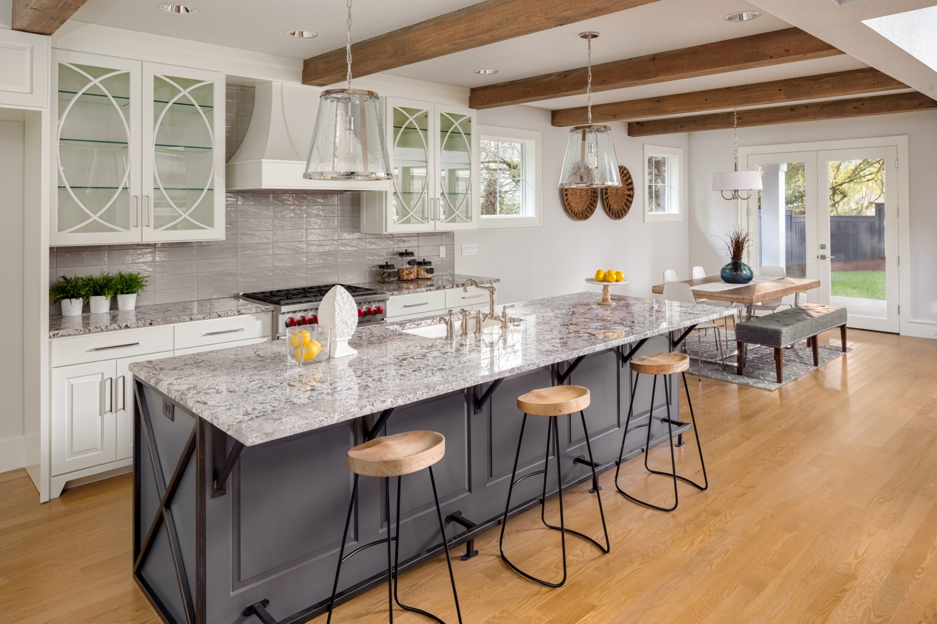 What a beautiful Cape Cod style old world kitchen. It's not every day you run into stained wood beams on the ceiling. Couple that with monotone wood flooring to emphasize the wooden beams, and you have a kitchen that lights up the room.
