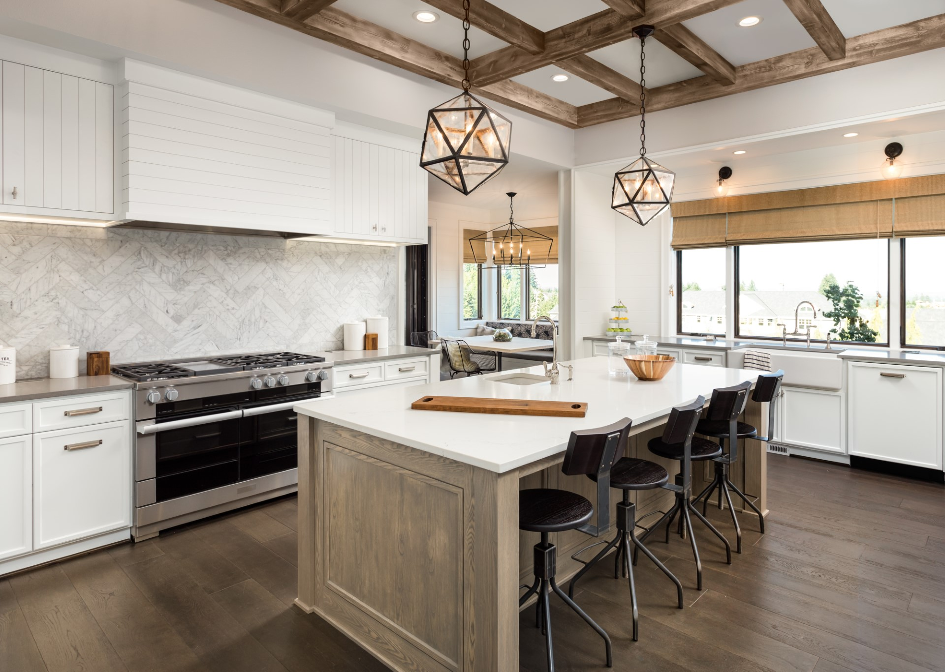 This kitchen takes on a very coastal feel, but the main decoration is the pendant lights with distinct geometric ambiance that catches your eye. The stained wood beams help make this layout truly majestic. The call