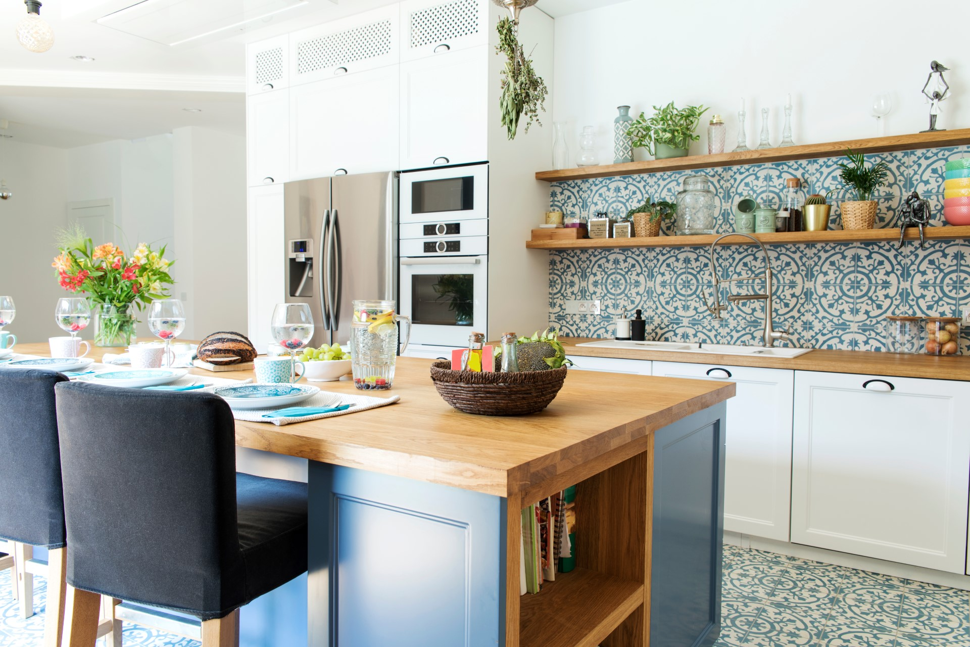 A fun quirky design like this deserves a hoorah. The intricate designs of tiles helps build character and depth while the blue brings about peace and harmony with a touch of wood for that piece full nature ambiance.