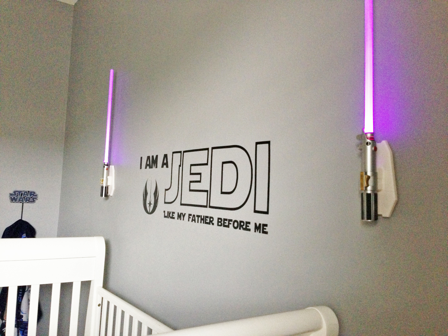 These pink Jedi light sabers are one-of-a-kind for this crib room.