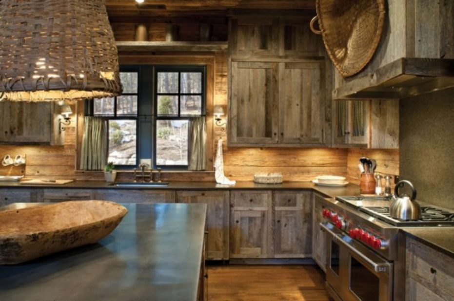 This rustic farmhouse style kitchen features worn and weathered dark stain cabinets that provides a very natural feel. It's a great idea if you're looking for a warm comforting kitchen.