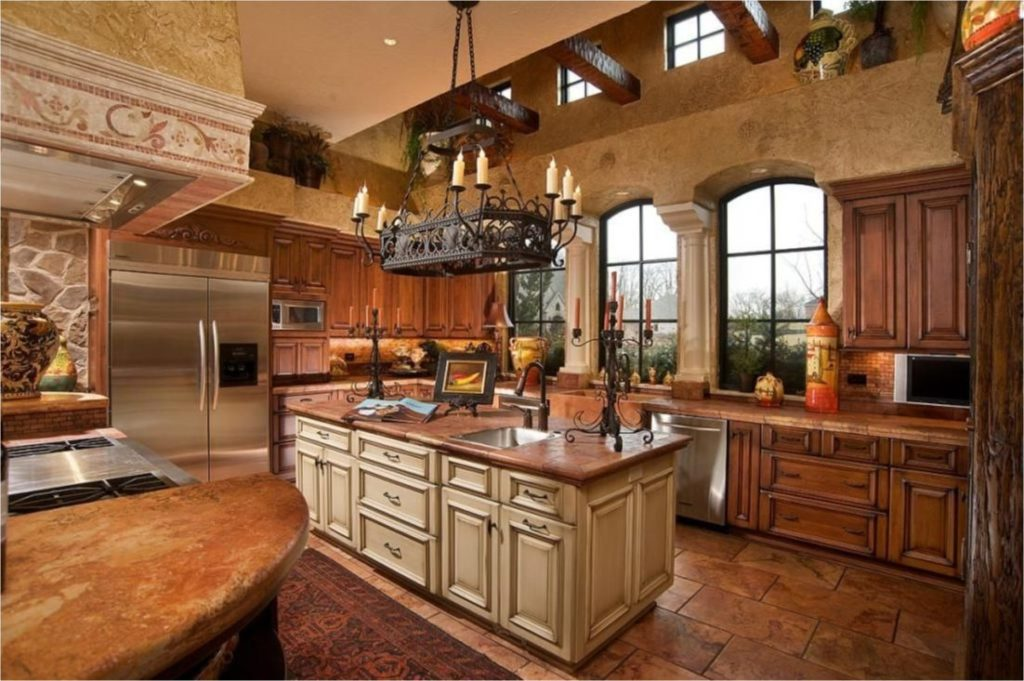 When you're going for a luxurious farmhouse kitchen, there's no better way to do it than adding dual sinks, an island countertop with lighting, a built in extravagant sub-zero fridge and rustic tile flooring.