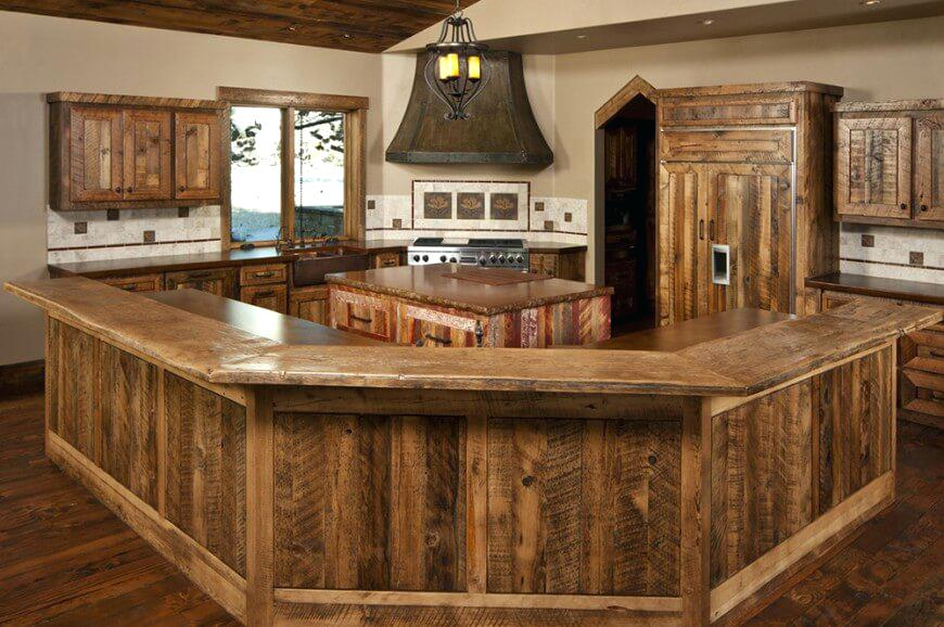 A farmhouse kitchen with dark countertops and wood flooring is a great idea to add warmth to your kitchen.