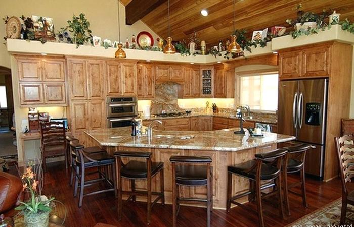 Remodeling your kitchen with a rustic farmhouse design can provide you a warm feel especially if you add an island with adequate ceiling and good lighting.